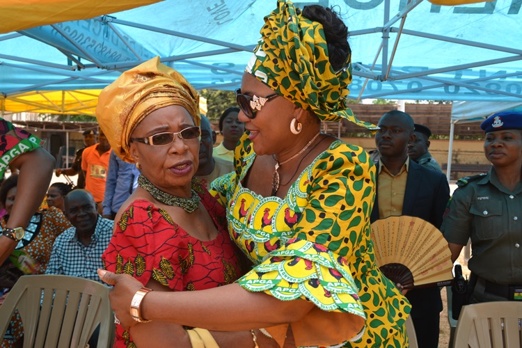 Former Governor of Anambra State, Dame Virgy Etiaba and wife of the Governor of Anambra State, Chief (Mrs.) Ebelechukwu Obiano exchanging pleasantries during the Campaign stop at Anaedo Social Club ground Nnewi.