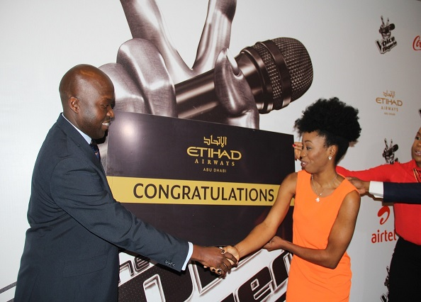 (L-R) George Mawadri, Etihad Airways' General Manager, Nigeria, presents Agharese Emokpae, winner of the first season of The Voice Nigeria, with her tickets to Abu Dhabi by Etihad Airways recently