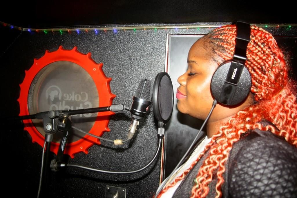 """Teshola hits the mic as he records his own cover of Coca-Cola's """"Taste the Feeling"""" anthem"""