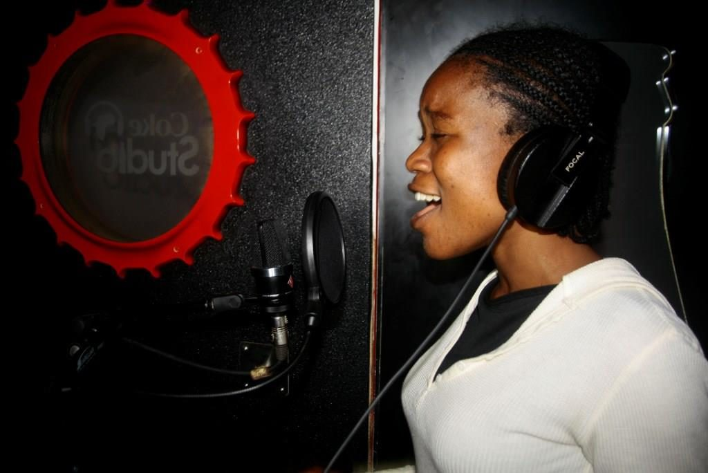 """Blessing singing her heart out during her recording of own cover of Coca-Cola's """"Taste the Feeling"""" anthem"""