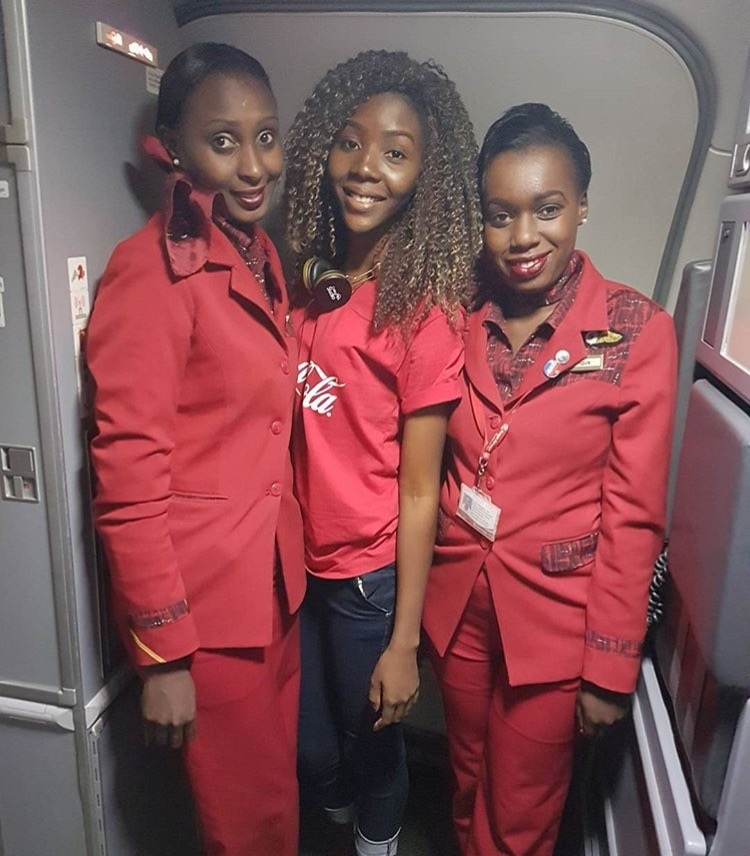 Anna taking a selfie with the Kenya Airways cabin crew ''Awesome flight, great hospitality...couldn't have asked for more. Thanks Coca-Cola'' - Anna