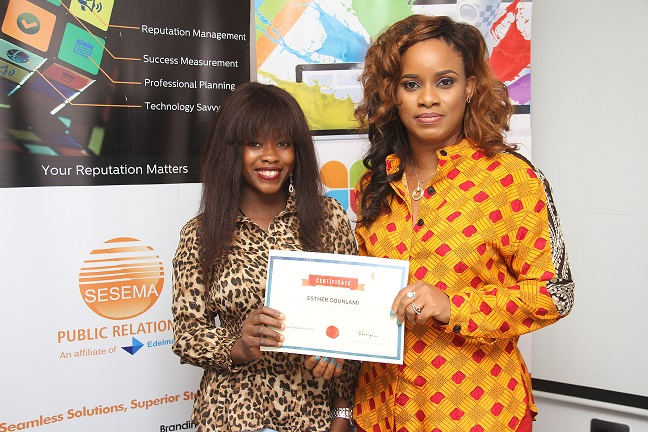 L-R: Esther Odunlami receiving her Certificate of participation from the MD Sesema PR, Tampiri Irimagha-Akemu at the Corporate Communications Interactive Forum (CCIF) organised by Sesema PR in Lagos.