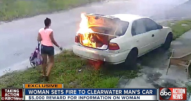 woman burns car