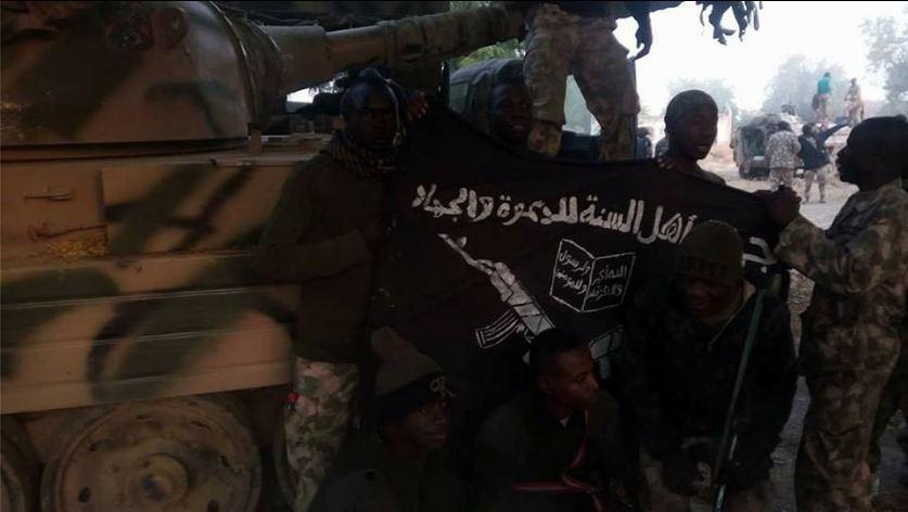 Nigerian army pose with boko haram flag