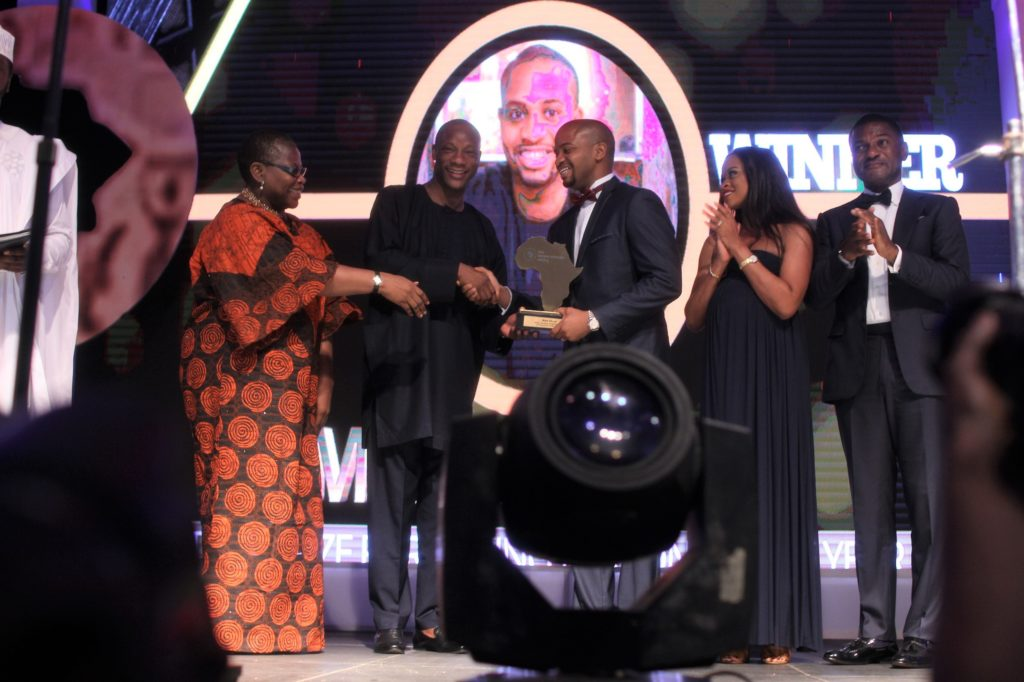MARK OKOYE (and his wife) Phillipa as he receives his aard for TFAA Prize for Young Person of the Year