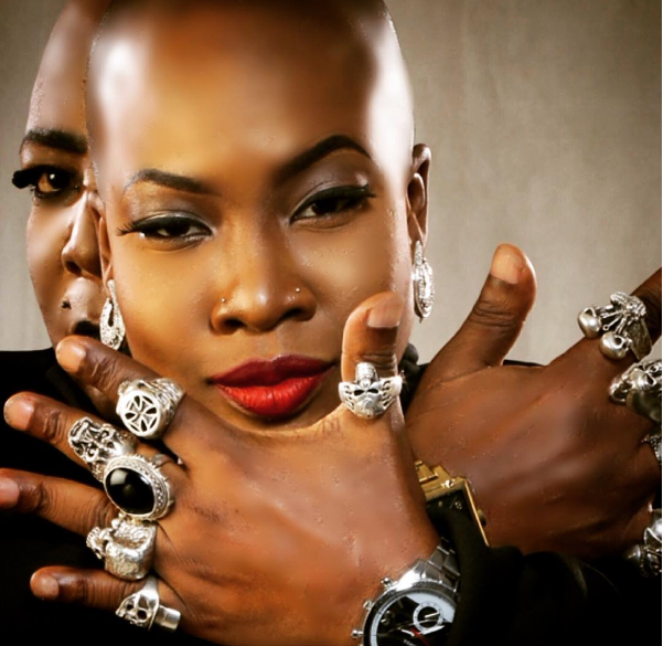 Slick Charly Boy Cuddles Daughter Dominique In New Photo 2