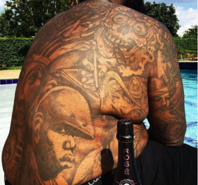 Rick ross draws tattoo of notorious b i g on his back for The girl with the lower back tattoo review