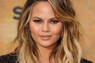 Chrissy Teigen lands on Women Of The Year Glamour cover.
