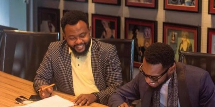 D'banj signs a major deal with Sony.