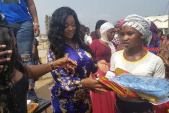 Jackie Appiah donates items to Kayayei to celebrate her birthday.