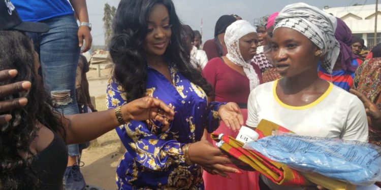 Jackie Appiah donates items to Kayayei to celebrate her birthday.