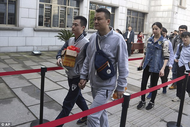 Gay couple Sun Wenlin and Hu Mingliang outside the courtroom in China